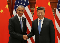 President Barack Obama and Chinese President Xi Jinping shake hands during their meeting in Hangzhou on September 3, 2016, where they ratified the Paris climate agreement. (Credit: How Hwee Young/AFP/Getty Images) Click to Enlarge.
