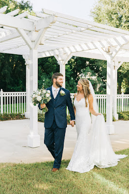 groom and bride walking at Lake Mary Events Center