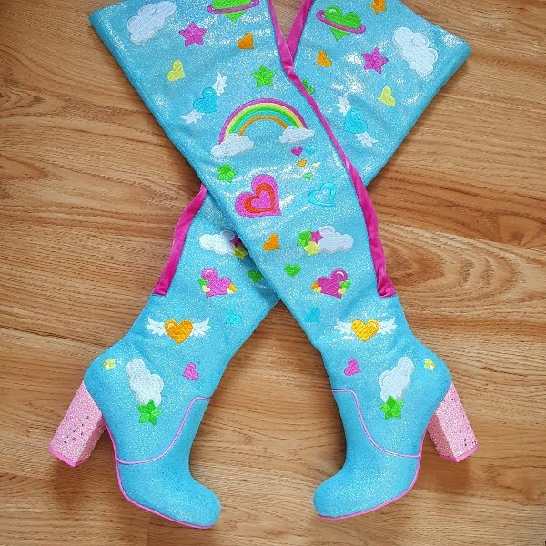 blue embroidered thigh high boots on wooden floor