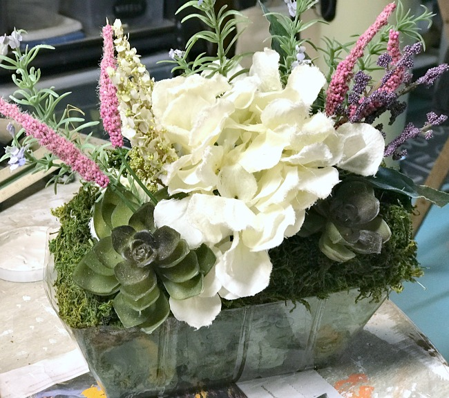 Faux flowers in a foam basket