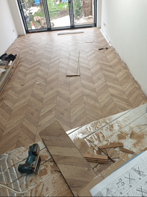 New chevron wooden flooring installation Victorian home renovation