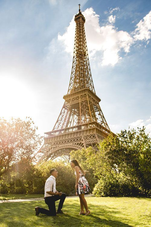 Will You Marry Me - Romantic Way Proposing at  Eifel Tower - the man in white shirt and black pants, while the girl in flower printed dress