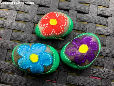 Painted stones with flowers