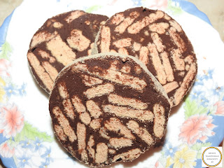 Reteta salam de biscuiti cu mascarpone si miere de casa traditional preparat cu ciocolata neagra nuci coapte si esente de vanilie migdale si rom retete culinare prajituri torturi si deserturi dulci fara coacere rapide,