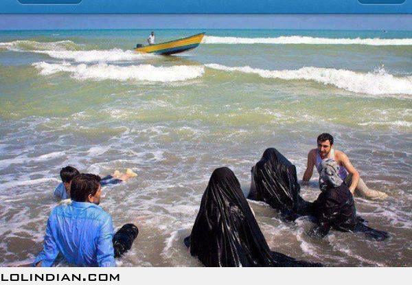 beach at in burkas the Muslim women