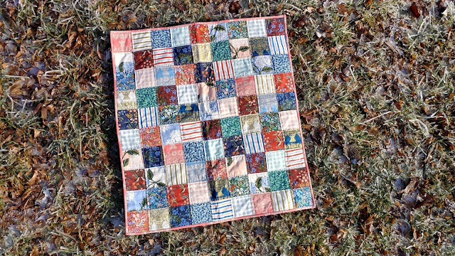 Simple patchwork baby quilt made with Rifle Paper Co. fabric from Cotton + Steel