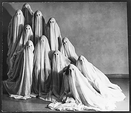 Vintage photo of a theatrical production. Actors dressed as ghosts in gauze sheets. Redbad Standards and Other Stories of Hell. marchmatron.com