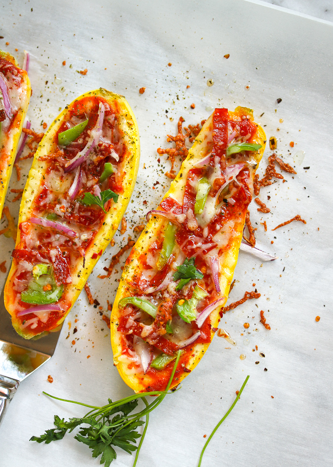"""Pizza is always a favorite around here, and zucchini and squash have been in abundance from my parents' garden they planted this year.  The natural option?  Make """"pizza stuffed"""" squash boats!"""