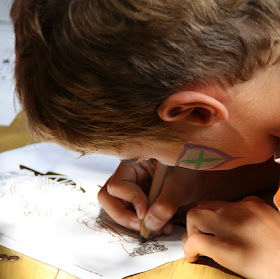 Boy filling in an activity sheet
