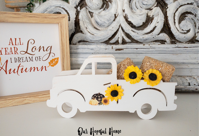 white painted pickup truck fall wall art hay bale sunflowers