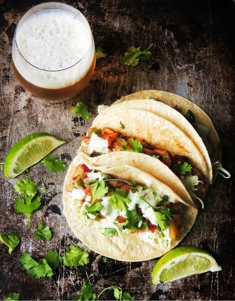"Slow Cooker Kalua Pork Tacos - Tender juicy pork, in a Hawaiian inspired sauce, wrapped in a warm corn tortilla. Your taste buds will say ""Hola"" to this tasty fusion taco! From www.bobbiskozykitchen.com"