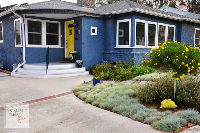 Beautiful and bold blue home with yellow front door :: OrganizingMadeFun.com