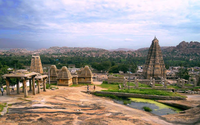 The gopurams (entrance towers) of the Virupaksha Temple, as viewed from the Hemkuta Hill in Hampi