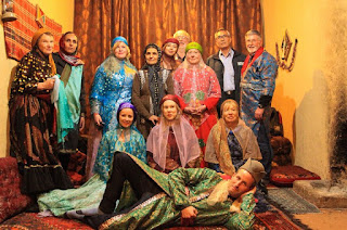 Iranians believe that Color plays a major role in their lives by the way it influences their moods and emotions. As you see in this photo, our curious travelers tried on nomadic clothing.