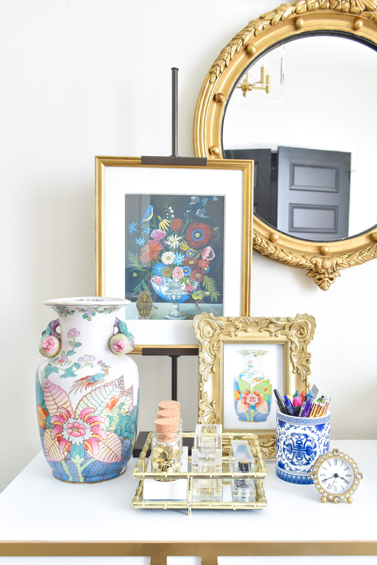 A feminine office with chinoiserie accents and a tobacco leaf vase. Includes a free printable! | #decor #homeoffice #office #girlboss #homedecor #interiordesign #interiordetails #chinoiserie #tobaccoleaf #antiques