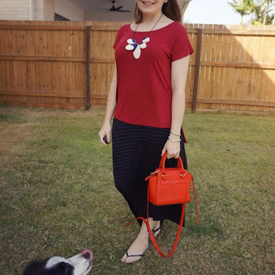 awayfromblue Instagram | statement necklace and burgundy tee with striped maxi skirt