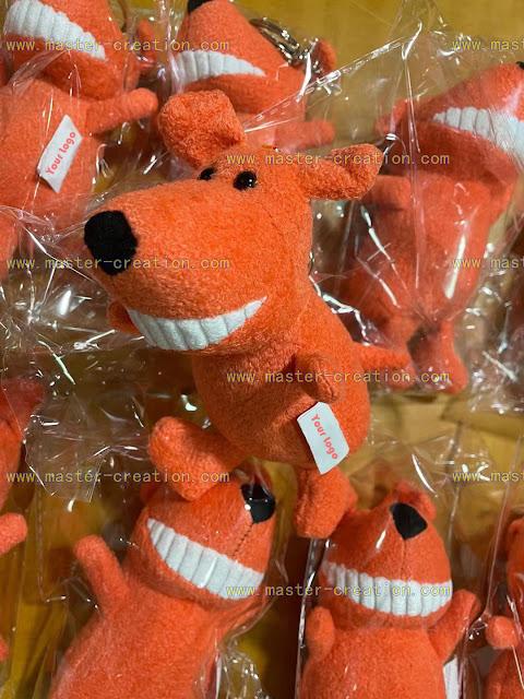 Orange plush dog