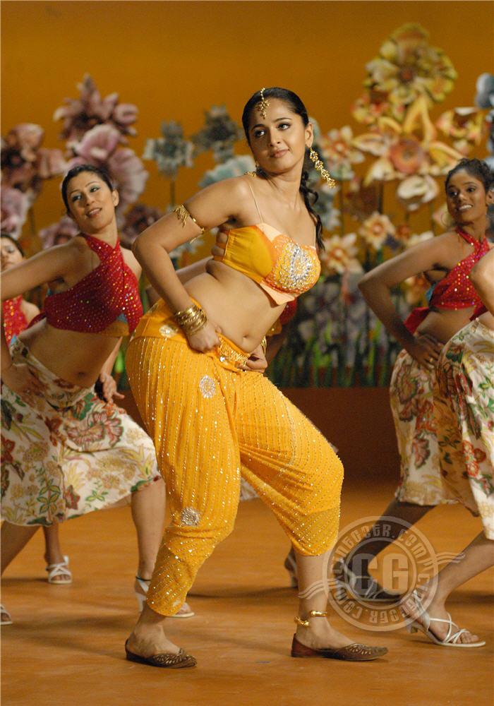 Anushka Shetty Looks super cute in orange Choli in a Dance Song