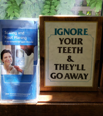 """Funny sign, """"Ignore your teeth and they'll go away."""""""