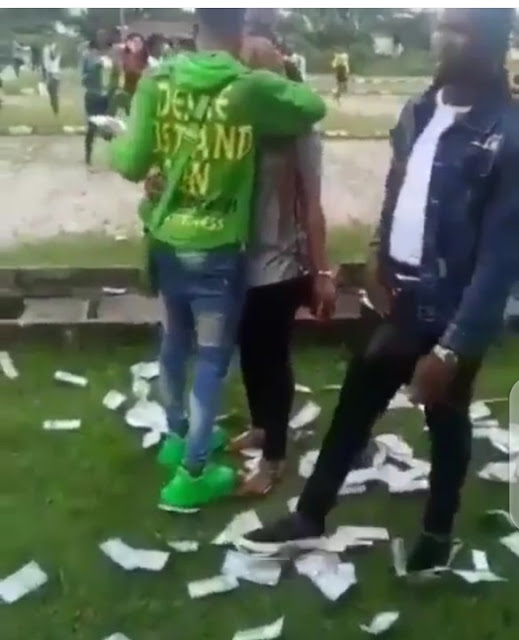 ABSU girls rush to pick money a guy was spraying at his girlfriend