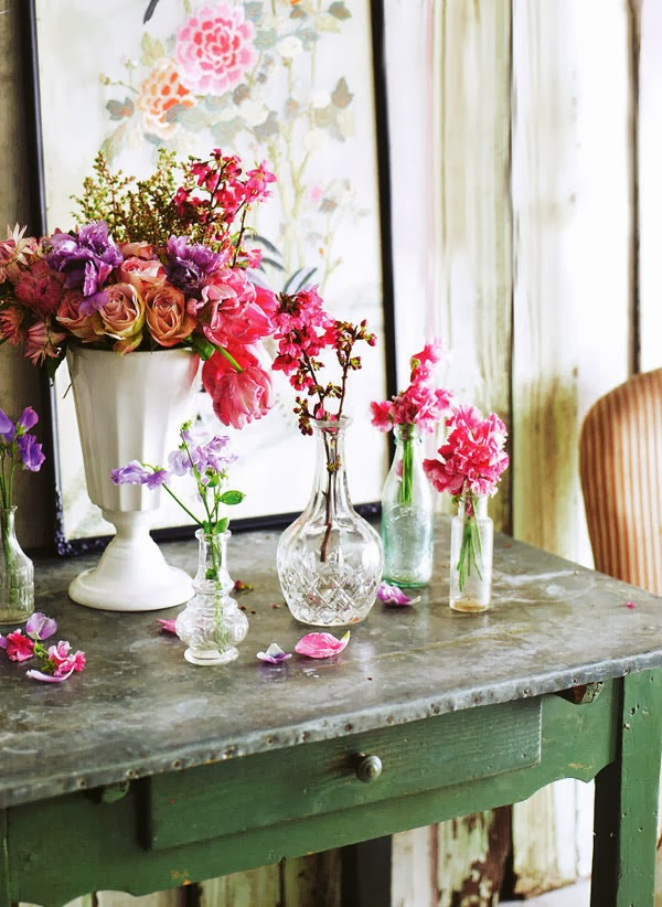 Flower arranging in cut glass vases