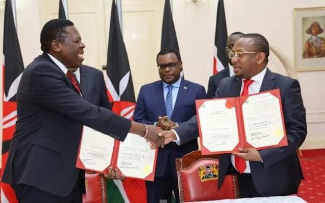 Nairobi Governor Mike Sonko with Devolution CS Eugene Wamalwa. PHOTO | BMS