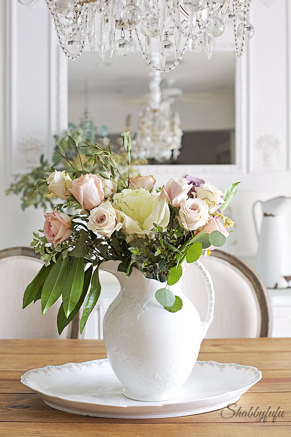 floral arranging in a shabby chic style on a farmhouse table
