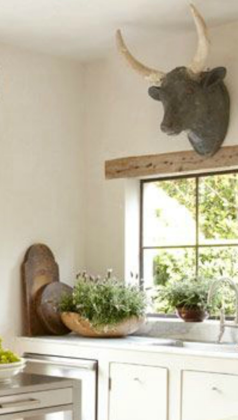 Antique bull head on wall of French Country kitchen! Pamela Pierce's gorgeous home with sophisticated French Country decor and European farmhouse charm on Hello Lovely Studio