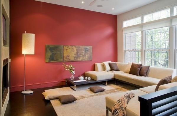 غرفة جلوس كنب متصل بيج وخداديات بنية اللون
