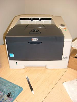 kyocera printer close to a pen