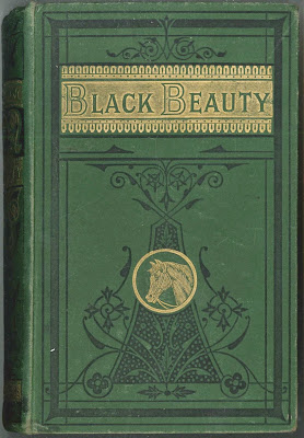 "A green and gold cover for ""Black Beauty."""