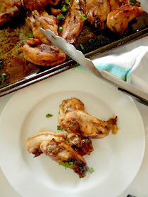 Slow Cooker Asian Chicken Wings...cooked on LOW in the slow cooker, then broiled to perfection right before eating.  A sweet, spicy sauce gives them a delicious glaze! (sweetandsavoryfood.com)