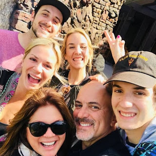 Tom Vitale clicking selfie with her family