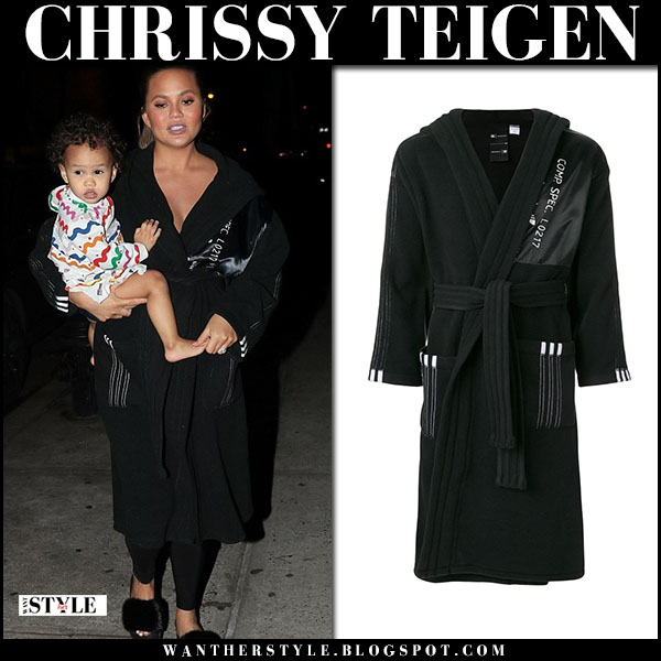 Chrissy Teigen in long black coat baby bump fashion march 1