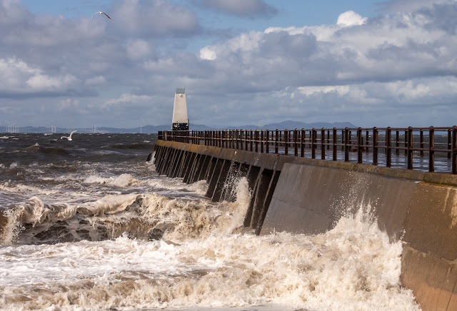 Photo of waves battering Maryport pier