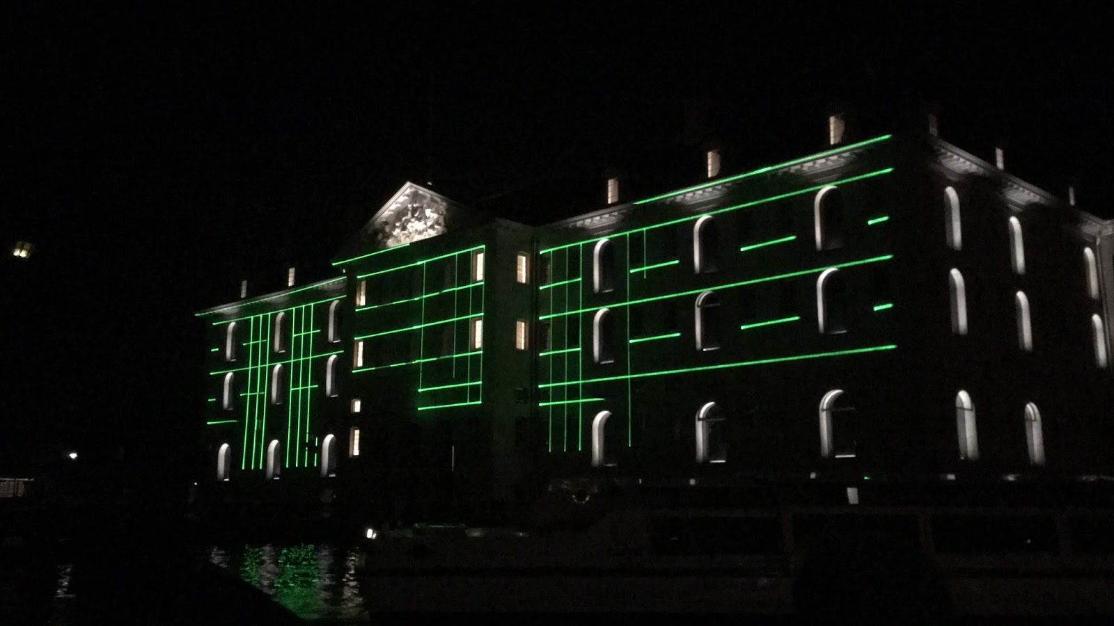 An Amsterdam light festival display as seen from a canal boat.