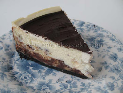 A close up photo of a slice of chocolate chip ricotta cheesecake.