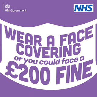 Wear a face covering or £200 fine UK
