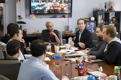 Emma Thompson talks to her all male writing staff in the writer's room in the 2019 film Late Night