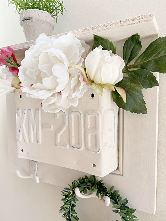 cabinet door with license plate filled with flowers