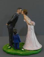 coppia sposi ritratti per torta con figli cake topper figlia orme magiche