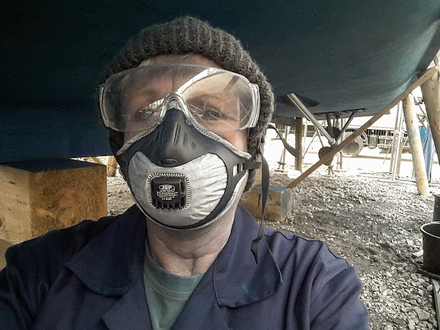 Photo of me sanding the old antifoul paint on Ravensdale's hull