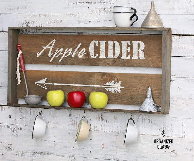 Photo of an apple cider crate/sign/shelf.