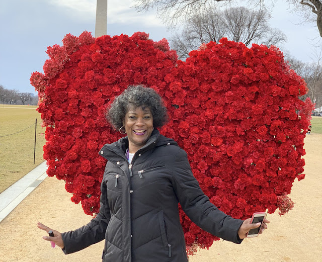Florist makes a big flower heart for the national mall