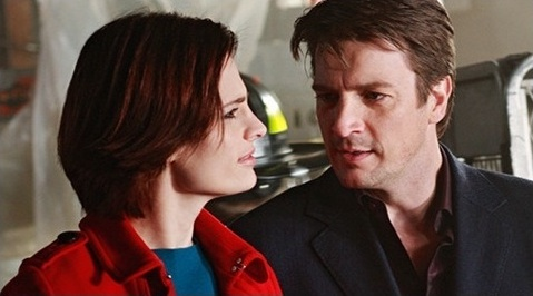 Beckett and Castle facing one another in close-up