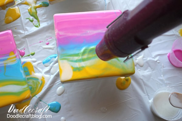 How to Make Resin Rainbow Sunset Coasters DIY with envirotex lite high gloss resin and acrylic paint pouring techniques.