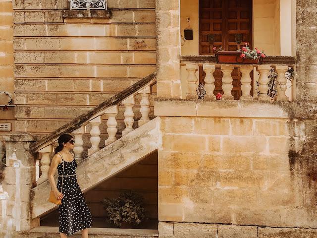 Malta holiday - girl in navy dress outside historical Maltese building