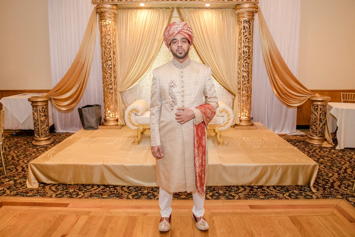 Typical Indian Groom, standing In-front of the Mandap, an altar that is believed to unite the bride and groom.