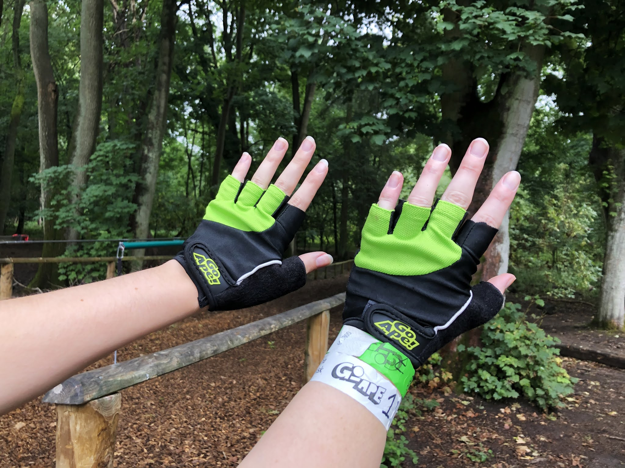 Two pairs of hands wearing the fingerless Go Ape gloves