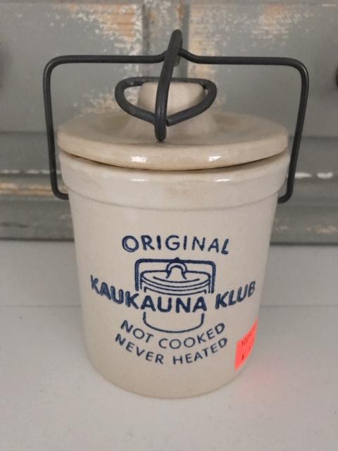 beige cheesecrock blue Kaukauna Klub logo